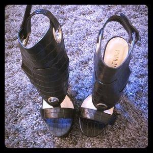Black heels (never worn)